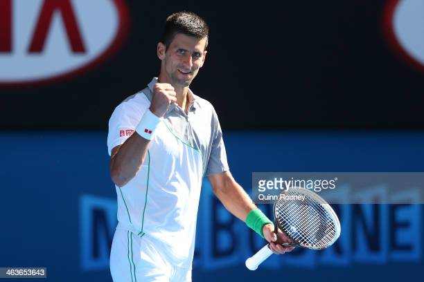 Novak Djokovic of Serbia celebrates winning his fourth round match against Fabio Fognini of Italy during day seven of the 2014 Australian Open at...