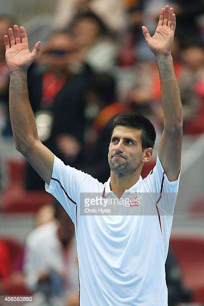 Novak Djokovic of Serbia celebrates winning his match against Grigor Dimitrov of Bulgaria during day seven of the China Open at the National Tennis...