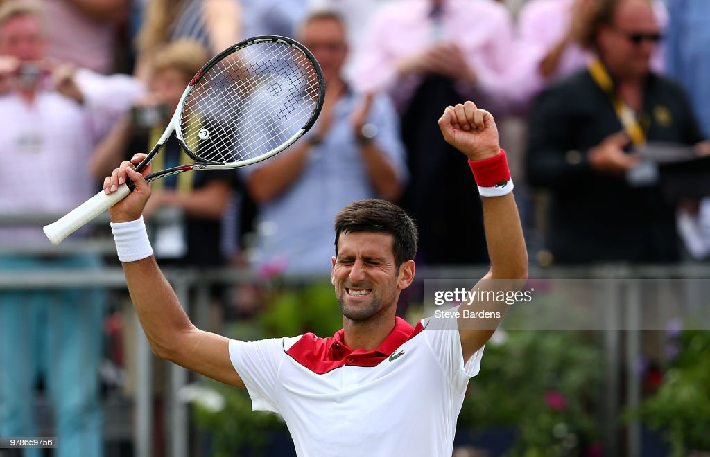 Novak Djokovic of Serbia celebrates winning his match against John Millman of Australia on Day Two of the Fever-Tree Championships at Queens Club on June 19, 2018 in London, United Kingdom.