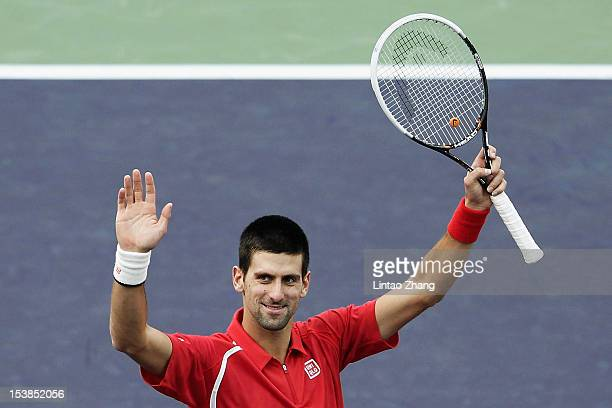 Novak Djokovic of Serbia celebrates winning his Men's Singles match against Grigor Dimitrov of Bulgaria during day four of Shanghai Rolex Masters at...
