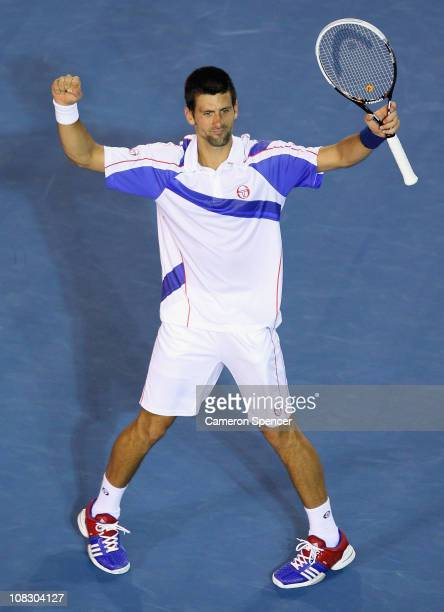 Novak Djokovic of Serbia celebrates winning his quarterfinal match against Tomas Berdych of the Czech Republic during day nine of the 2011 Australian...