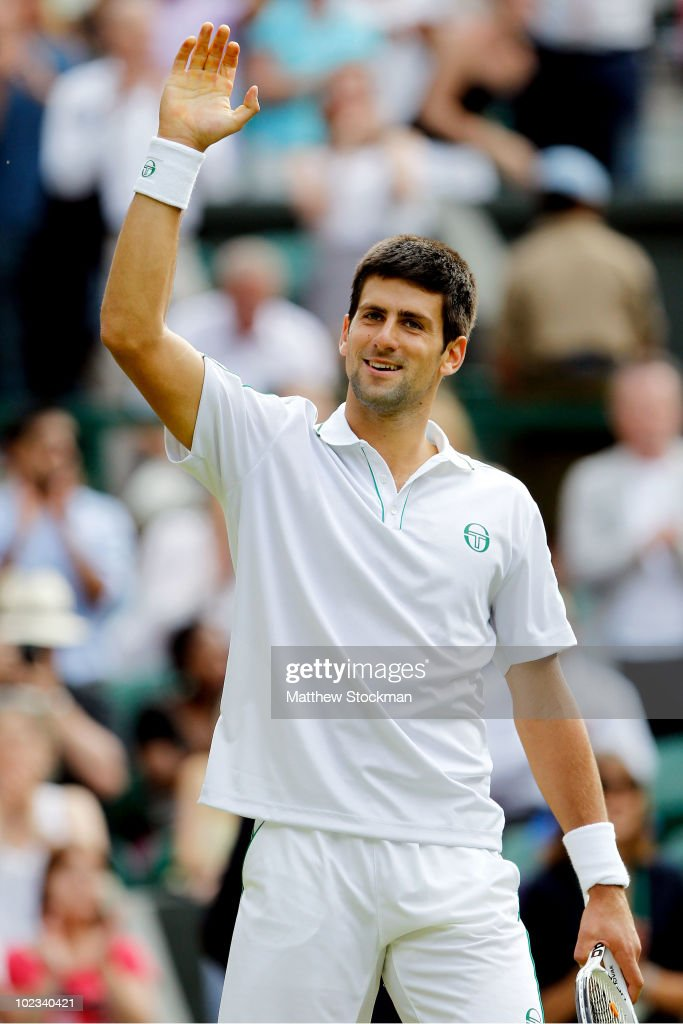 Novak Djokovic of Serbia celebrates winning his second round match against Taylor Dent of USA on Day Three of the Wimbledon Lawn Tennis Championships at the All England Lawn Tennis and Croquet Club on June 23, 2010 in London, England.