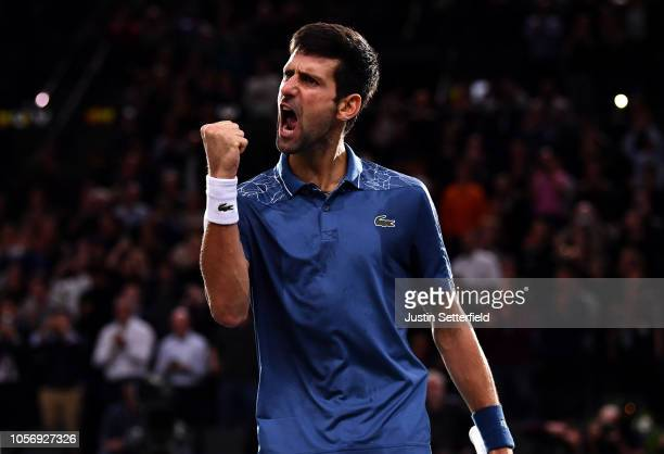 Novak Djokovic of Serbia celebrates winning his Semi Final match against Roger Federer of Switzerland on Day 6 of the Rolex Paris Masters on November...