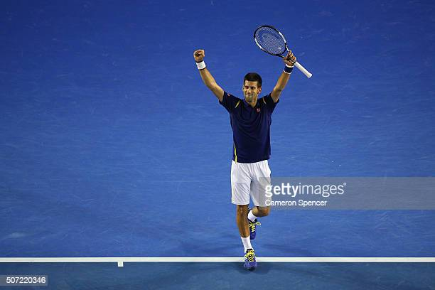 Novak Djokovic of Serbia celebrates winning his semi final match against Roger Federer of Switzerland during day 11 of the 2016 Australian Open at...
