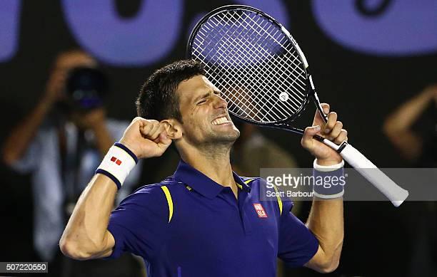 Novak Djokovic of Serbia celebrates winning his semi final match against Roger Federer of Switzerland during day 11 of the 2016 Australian Open at...