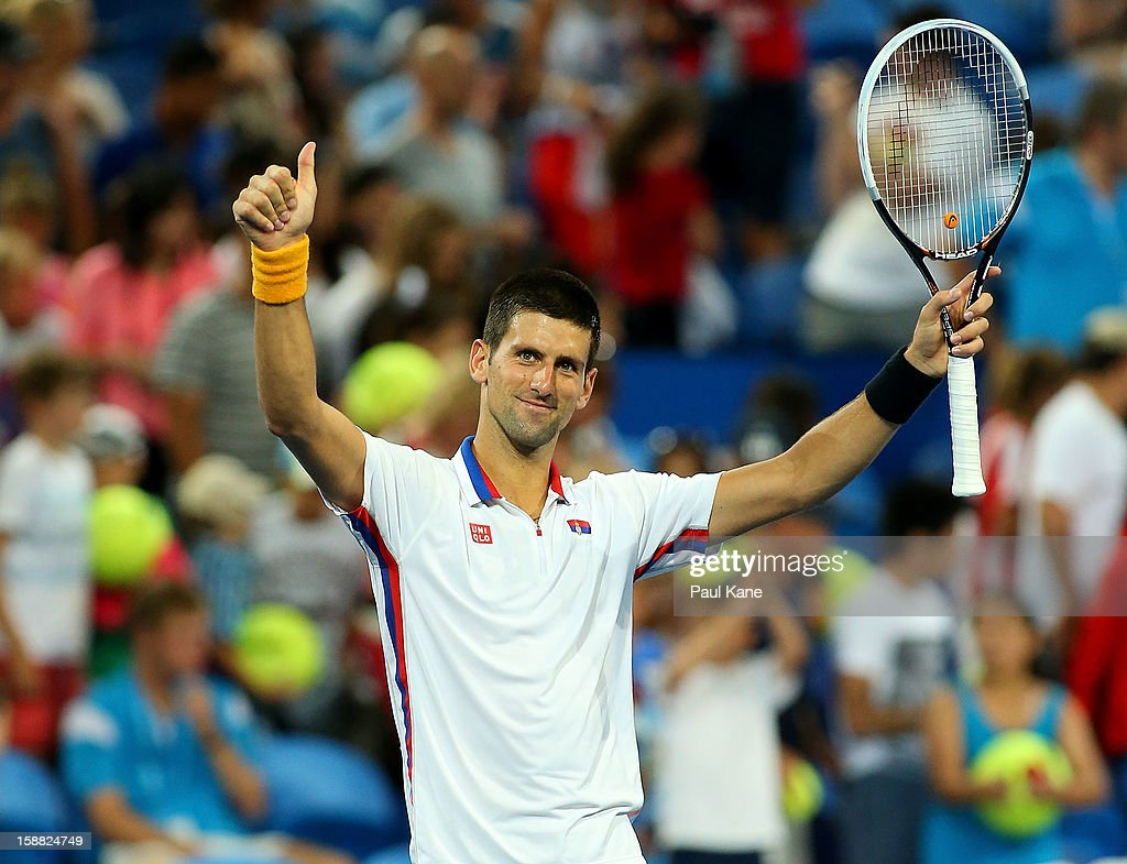 Novak Djokovic of Serbia celebrates winning his singles match against Andreas Seppi of of Italy during day three of the Hopman Cup at Perth Arena on December 31, 2012 in Perth, Australia.