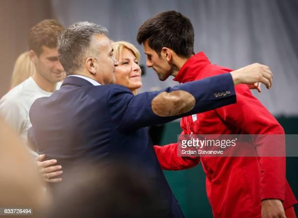 Novak Djokovic of Serbia celebrates winning match against Daniil Medvedev of Russia with his parents Srdjan Djokovic and Dijana Djokovic after the...