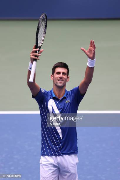 Novak Djokovic of Serbia celebrates winning match point during his Men's Singles second round match against Kyle Edmund of Great Britain on Day Three...