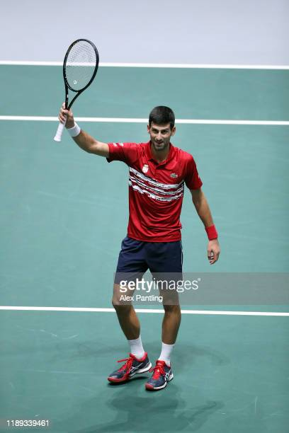 Novak Djokovic of Serbia celebrates winning match point in his quarter final singles match against Karen Khachanov of Russia on Day Five of the 2019...