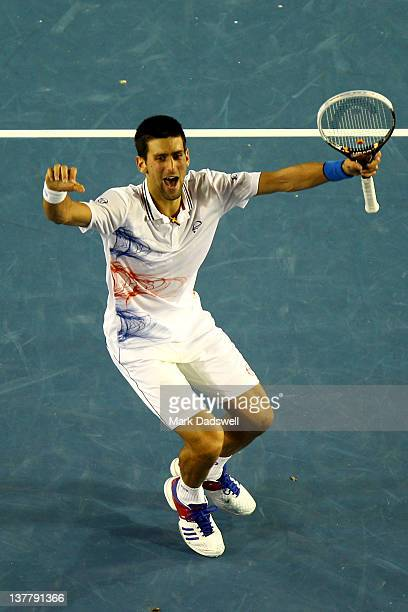 Novak Djokovic of Serbia celebrates winning match point in his semifinal match against Andy Murray of Great Britain during day twelve of the 2012...