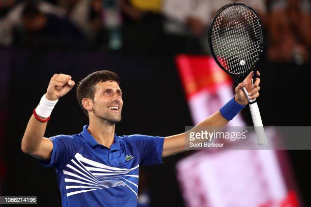 Novak Djokovic of Serbia celebrates winning match point in his men's semi final match against Lucas Pouille of France during day 12 of the 2019...