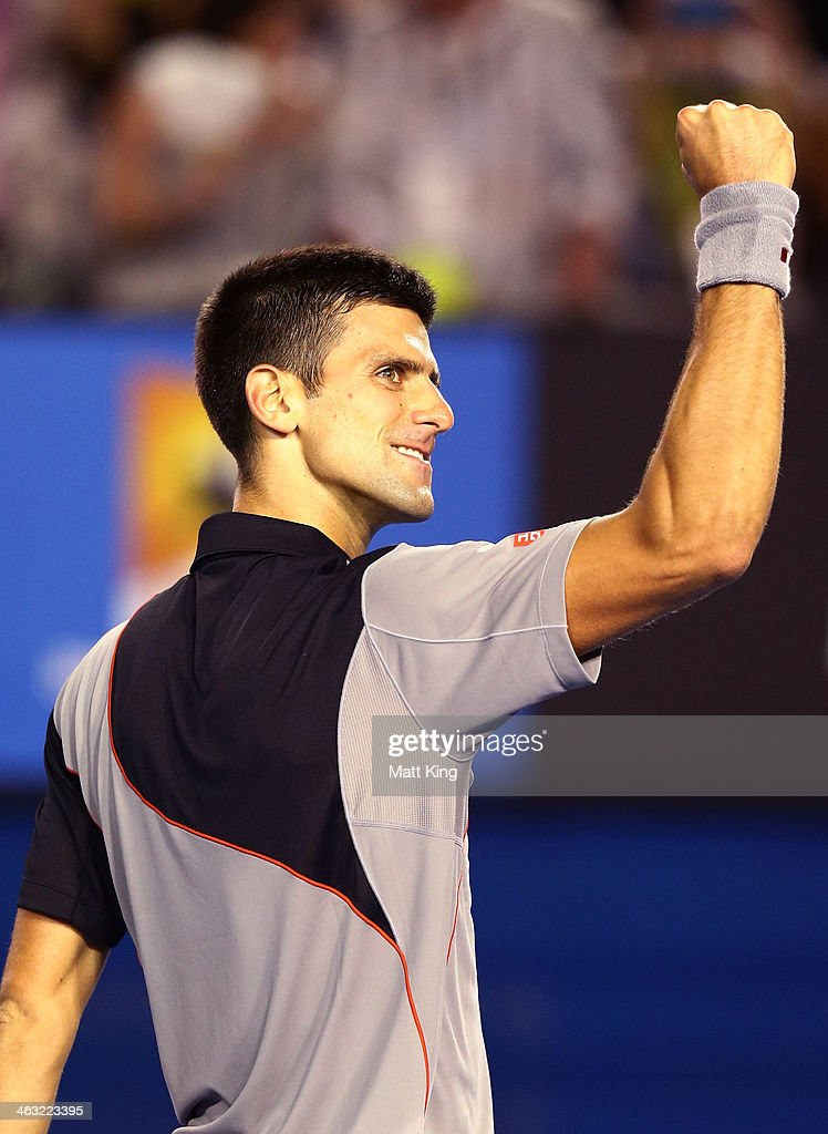Novak Djokovic of Serbia celebrates winning match point in his third round match against Denis Istomin of Uzbekistan during day five of the 2014 Australian Open at Melbourne Park on January 17, 2014 in Melbourne, Australia.