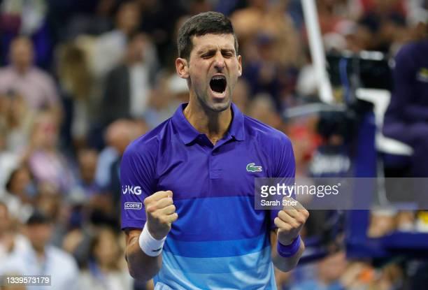 Novak Djokovic of Serbia celebrates winning match point to defeat Alexander Zverev of Germany during their Men's Singles semifinal match on Day...