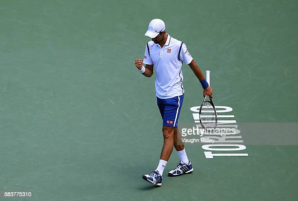 Novak Djokovic of Serbia celebrates winning the first set against Gilles Muller of Luxembourg on Day 3 of the Rogers Cup at the Aviva Centre on July...