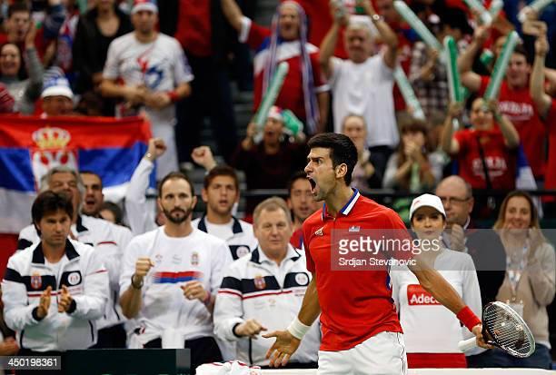 Novak Djokovic of Serbia celebrates winning the first set during the mens singles match between Novak Djokovic of Serbia and Tomas Berdych of Czech...