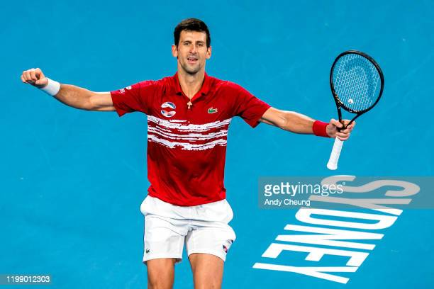 Novak Djokovic of Serbia celebrates winning the match point during his final singles match against Rafael Nadal of Spain on day 10 of the ATP Cup at...