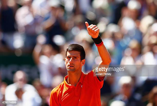 Novak Djokovic of Serbia celebrates winning the Men's Semi Final match against Andy Murray of Great Britain on day fourteen of the 2015 French Open...