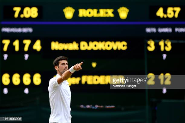 Novak Djokovic of Serbia celebrates winning the Men's Singles final against Roger Federer of Switzerland during Day thirteen of The Championships -...