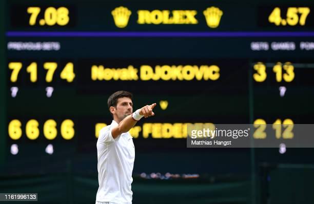 Novak Djokovic of Serbia celebrates winning the Men's Singles final against Roger Federer of Switzerland during Day thirteen of The Championships...