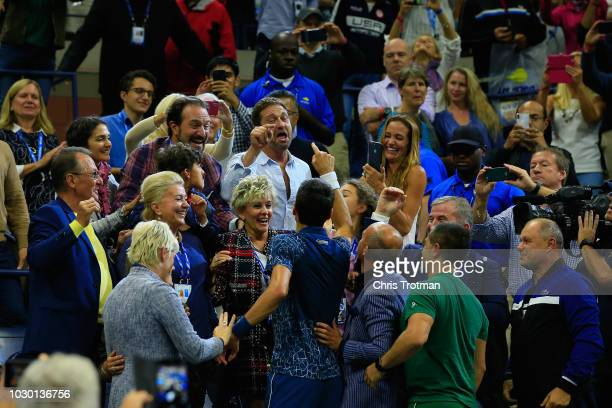 Novak Djokovic of Serbia celebrates with actor Gerard Butler after winning his Men's Singles final match against Juan Martin del Potro of Argentina...