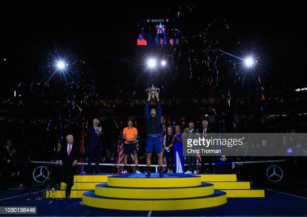 Novak Djokovic of Serbia celebrates with championship trophy after winning his Men's Singles final match against Juan Martin del Potro of Argentina...