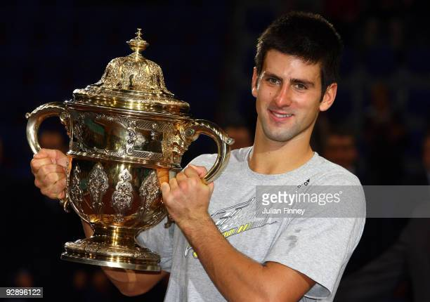Novak Djokovic of Serbia celebrates with the trophy after defeating Roger Federer of Switzerland in the final during Day Seven of the Davidoff Swiss...