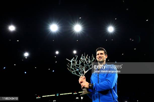 Novak Djokovic of Serbia celebrates with the trophy after victory in the Men's Singles Final match against Denis Shapovalov of Canada on day 7 of the...
