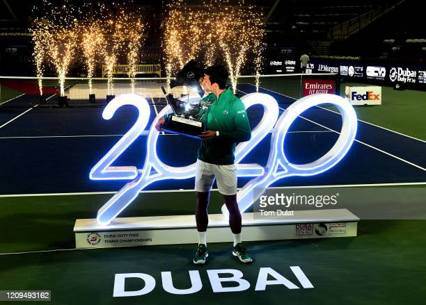 Novak Djokovic of Serbia celebrates with the trophy after winning his men's final match against Stefanos Tsitsipas of Greece on Day 13 of the Dubai...
