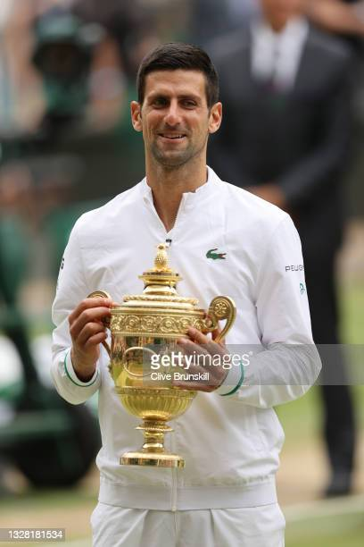 Novak Djokovic of Serbia celebrates with the trophy after winning his men's Singles Final match against Matteo Berrettini of Italy on Day Thirteen of...