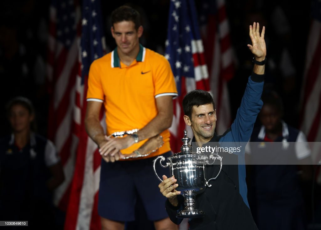Novak Djokovic of Serbia celebrates with the trophy after winning the men's Singles final match against Juan Martin del Potro of Argentina on Day Fourteen of the 2018 US Open at the USTA Billie Jean King National Tennis Center on September 9, 2018 in the Flushing neighborhood of the Queens borough of New York City.