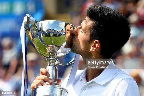 Novak Djokovic of Serbia celebrates with the trophy after winning the men's singles final against Gael Monfils of France during day seven of the...