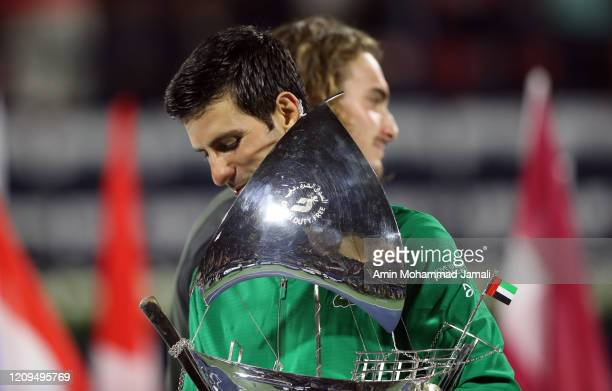 Novak Djokovic of Serbia celebrates with the victor's trophy after winning the final against Stefanos Tsitsipas of Greece Match Day thirteen of the...