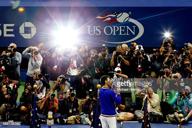 Novak Djokovic of Serbia celebrates with the winner's trophy after defeating Roger Federer of Switzerland during their Men's Singles Final match on...