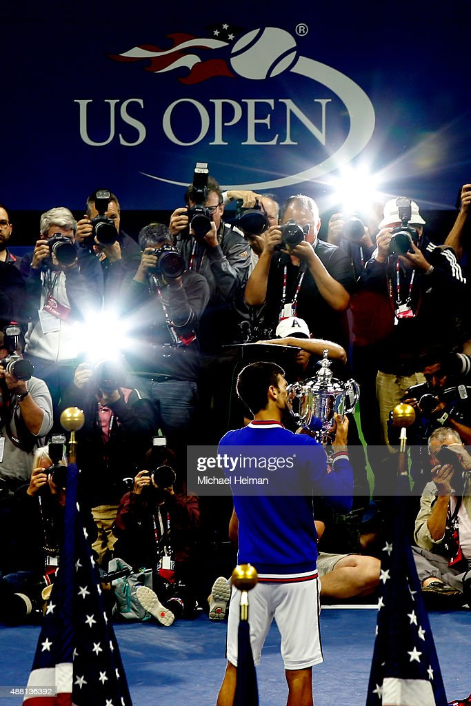 Novak Djokovic of Serbia celebrates with the winner's trophy after defeating Roger Federer of Switzerland during their Men's Singles Final match on Day Fourteen of the 2015 US Open at the USTA Billie Jean King National Tennis Center on September 13, 2015 in the Flushing neighborhood of the Queens borough of New York City. Djokovic defeated Federer 6-4, 5-7, 6-4, 6-4.