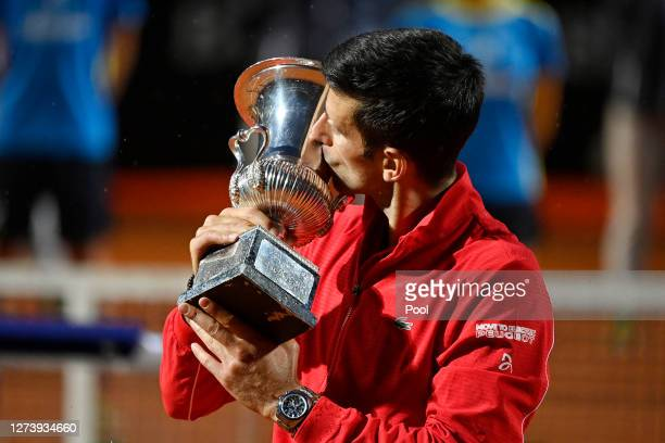 Novak Djokovic of Serbia celebrates with trophy after winning his men's final match against Diego Schwartzman of Argentina during day eight of the...