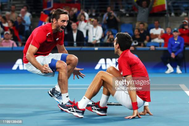 Novak Djokovic of Serbia celebrates with Viktor Troicki of Serbia after winning their doubles final against Feliciano Lopez and Pablo Carreno Busta...