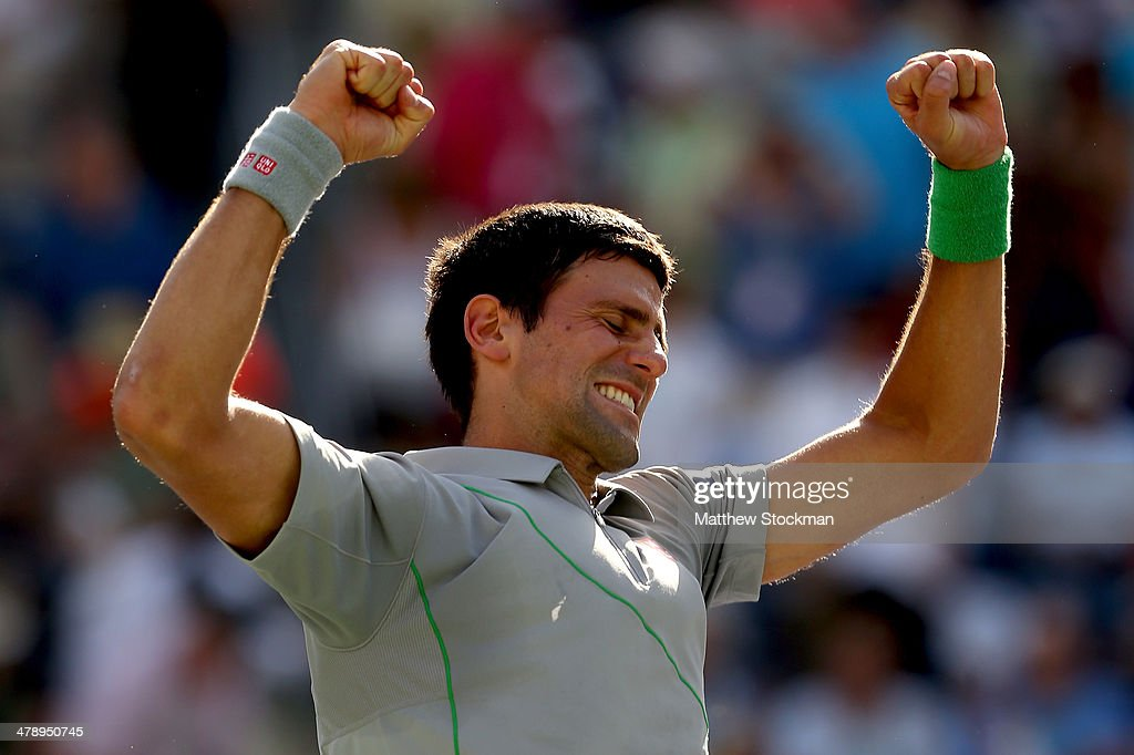 Novak Djokovic of Serbia celerbrates his win over John Isner during the semifinals of the BNP Parabas Open at the Indian Wells Tennis Garden on March 15, 2014 in Indian Wells, California.