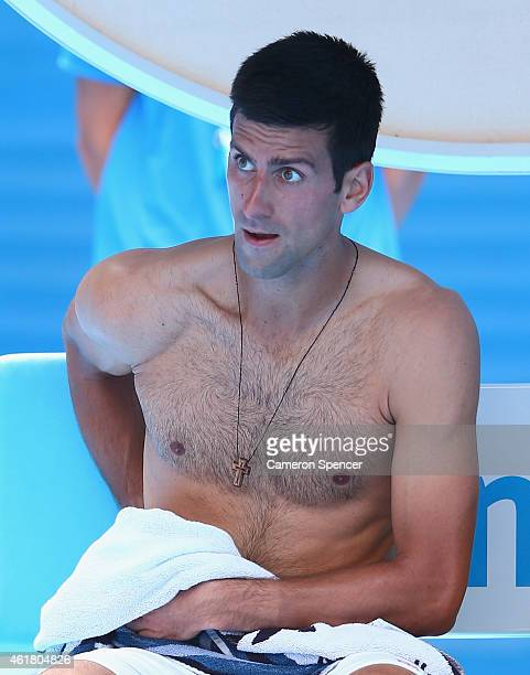 Novak Djokovic of Serbia changes his shirt in his first round match against Aljaz Bedene of Slovenia during day two of the 2015 Australian Open at...