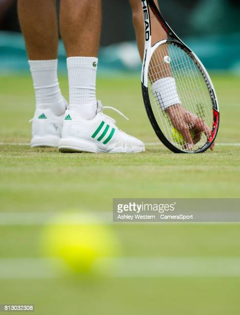 Novak Djokovic of Serbia checking the damage to the grass court during his Men's Singles Fourth Round Match today against Adrian Mannarino of France...