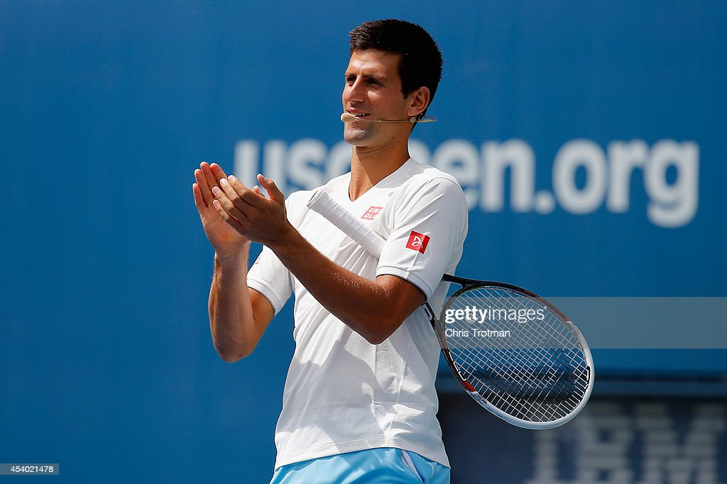 Novak Djokovic of Serbia cheers during Arthur Ashe Kids' Day prior to the start of the 2014 U.S. Open at the USTA Billie Jean King National Tennis Center on August 23, 2014 in the Flushing neighborhood of Queens in New York City.