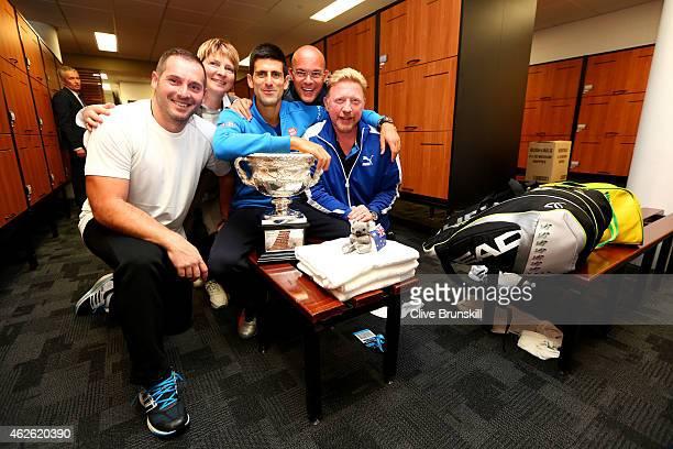 Novak Djokovic of Serbia coach Boris Becker agent Edoardo Artaldi and agent Elena Cappellaro pose with the Norman Brookes Challenge Cup after...