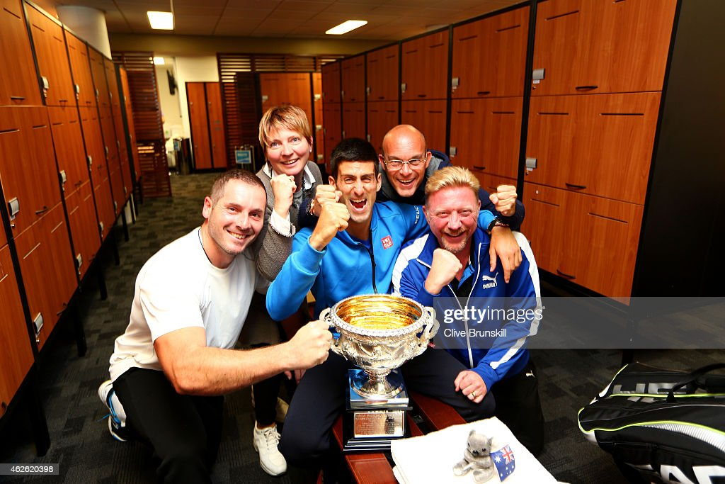 Novak Djokovic of Serbia, coach Boris Becker, agent Edoardo Artaldi, and agent Elena Cappellaro pose with the Norman Brookes Challenge Cup after Djokovic won his men's final match against Andy Murray of Great Britain during day 14 of the 2015 Australian Open at Melbourne Park on February 2, 2015 in Melbourne, Australia.