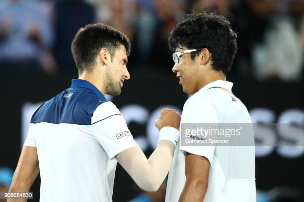 Novak Djokovic of Serbia congratulates Hyeon Chung of South Korea after losing their fourth round match on day eight of the 2018 Australian Open at...