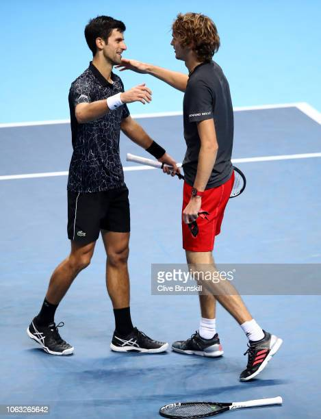Novak Djokovic of Serbia congratulates opponant Alexander Zverev of Germany on victory in the singles final during Day Eight of the Nitto ATP Finals...
