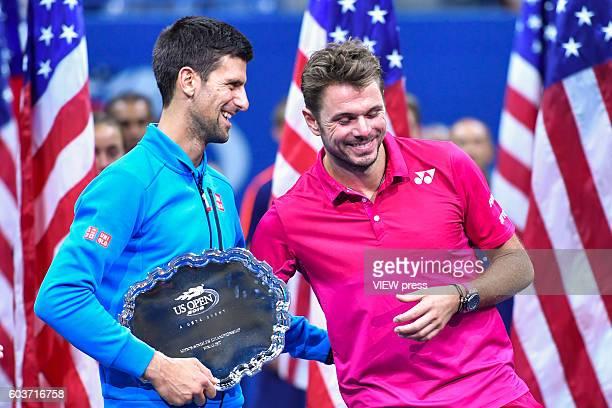 NEW YORK USA SEPT 11 Novak Djokovic of Serbia congratulates Stan Wawrinka of Switzerland after the latters victory during their Men's Singles Final...