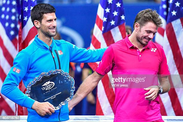 NEW YORK USA SEPT 11 Novak Djokovic of Serbia congratulates Stan Wawrinka of Switzerland after the latters victory during their Men's Singles Final...