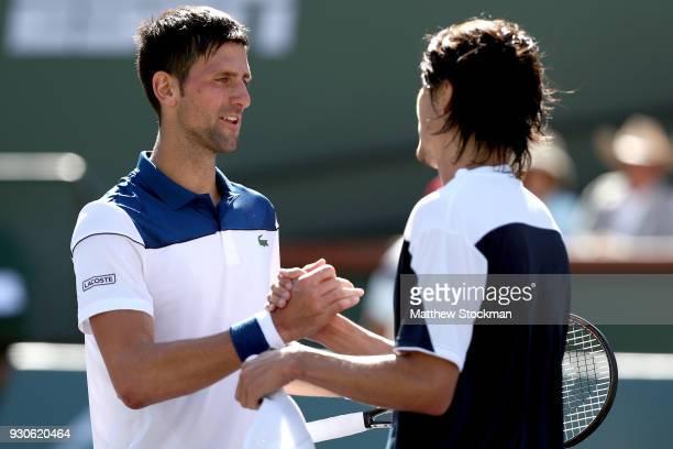 Novak Djokovic of Serbia congratulates Taro Daniel of Japan after their match during the BNP Paribas Open at the Indian Wells Tennis Garden on March...