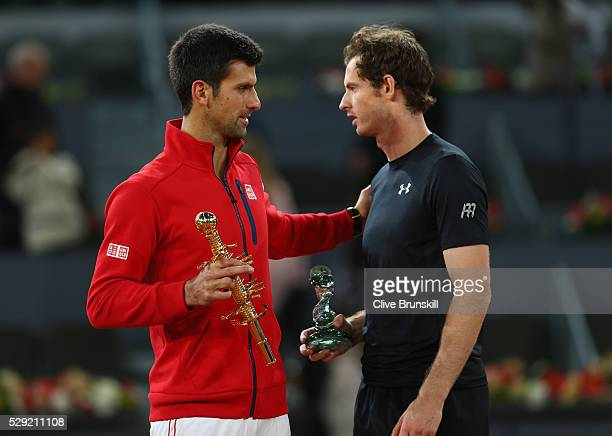 Novak Djokovic of Serbia consoles Andy Murray of Great Britain after his three set victory in the mens final during day nine of the Mutua Madrid Open...