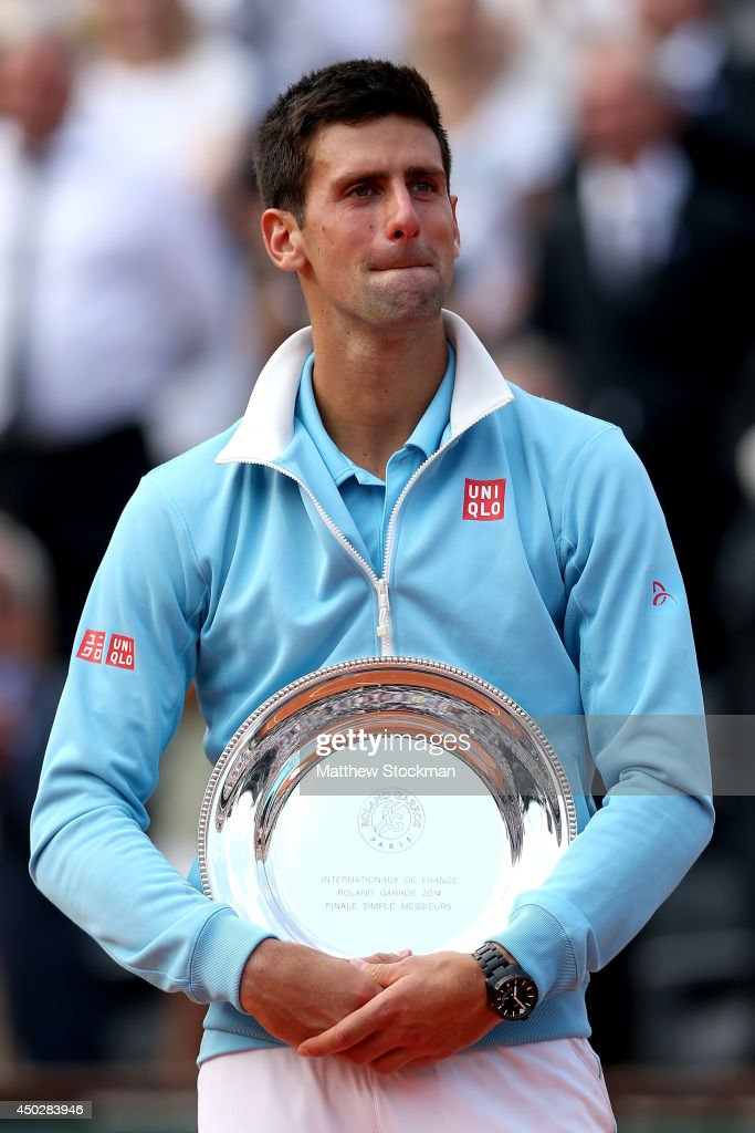 Novak Djokovic of Serbia cries after his defeat in the men's singles final match against Rafael Nadal of Spain on day fifteen of the French Open at Roland Garros on June 8, 2014 in Paris, France.