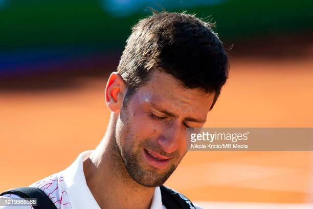 Novak Djokovic of Serbia cries after his match against Alexander Zverev of Germany on June 14, during the 3rd day of Summer Adria Tour, 2020 in...